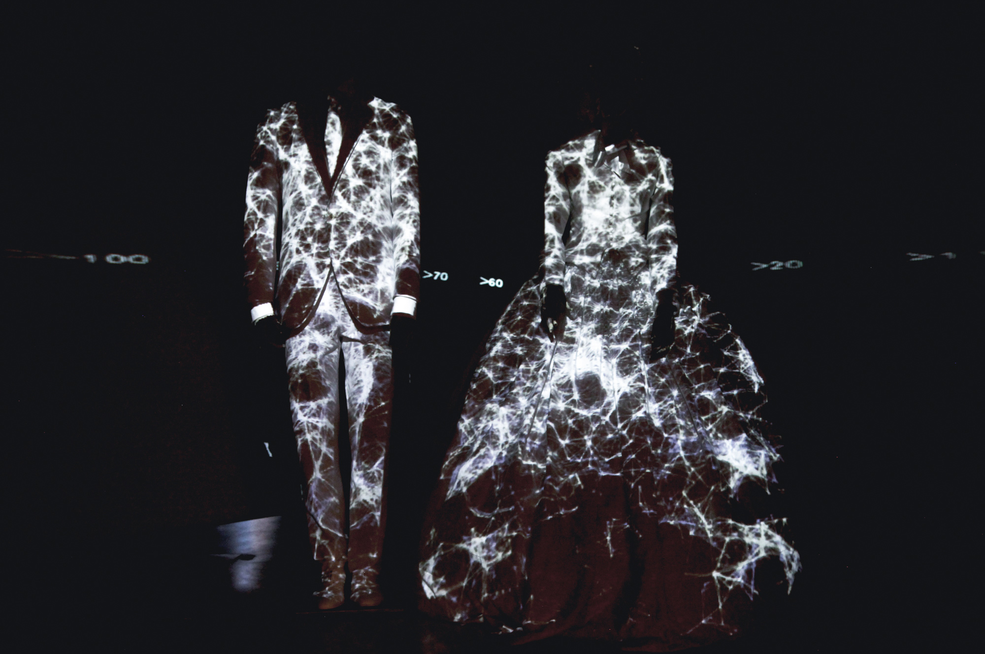 """Projection mapping onto dresses for the exhibition """"Santa Eulalia 1943–2011."""""""