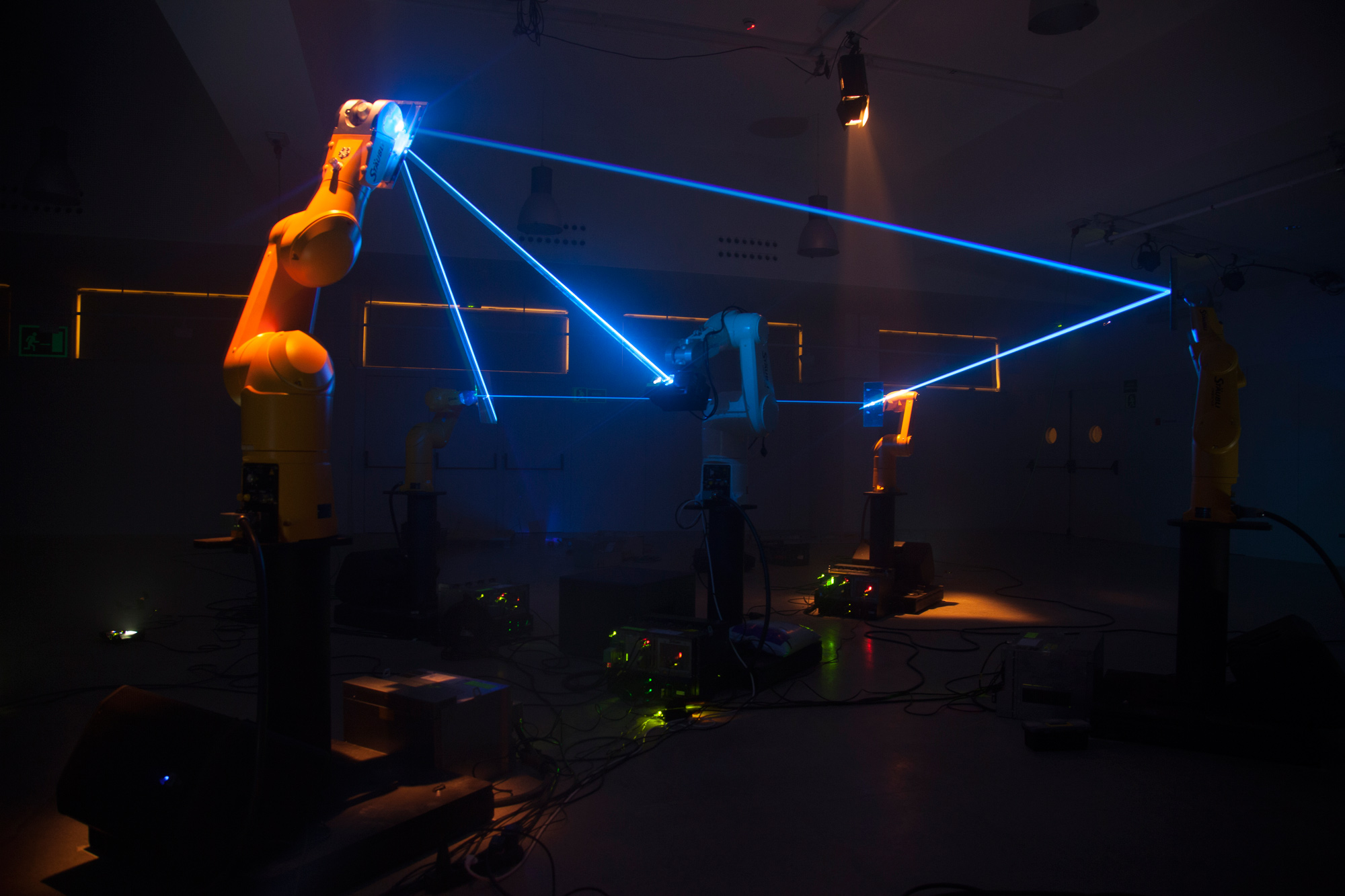 Robotic arms playing with a laser beam.