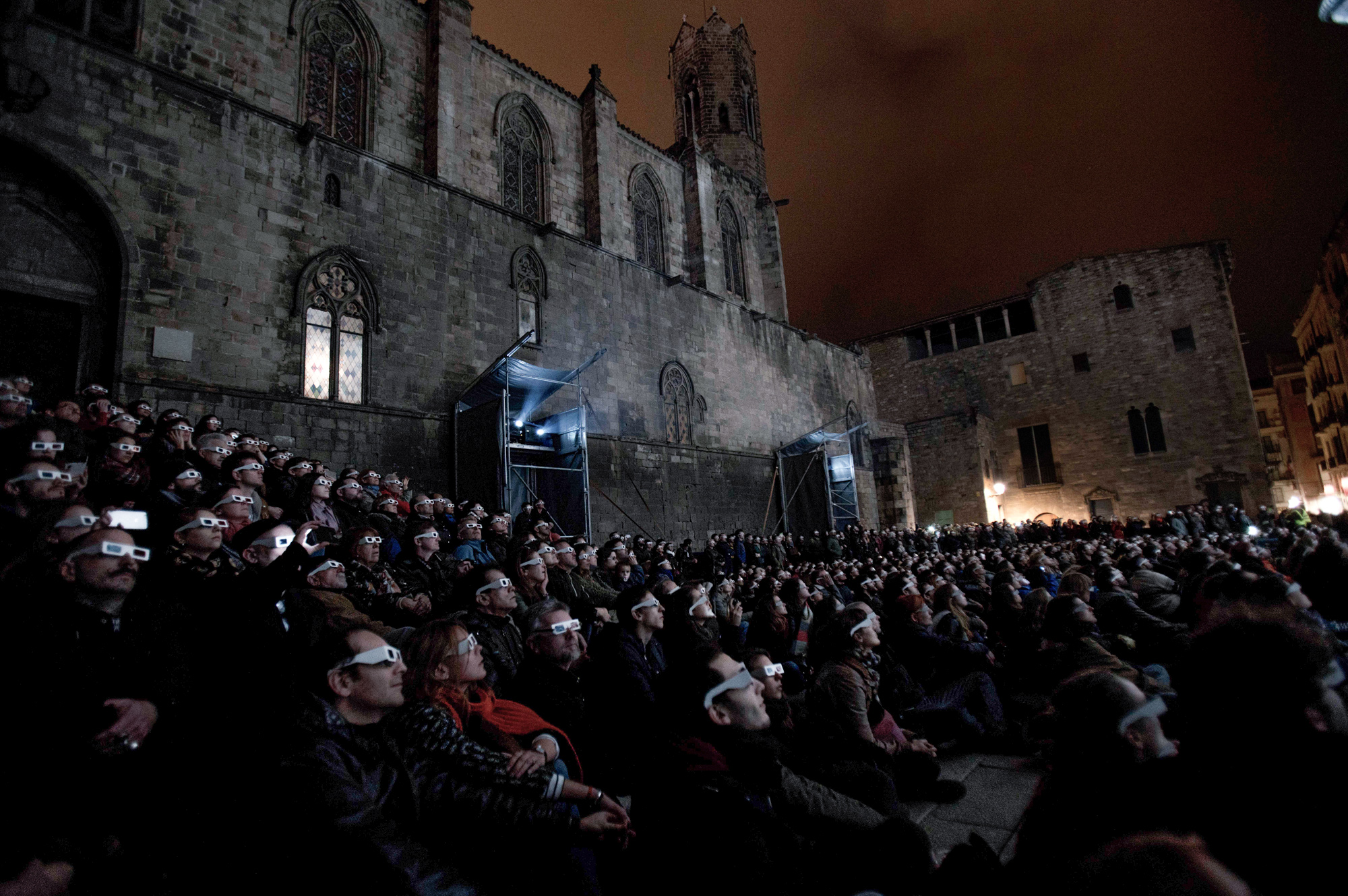 Audience attending Onionlab's 3D projection mapping show for Llum Bcn in Barcelona.